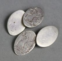 A pair of Gwendoline Whicker of Falmouth silver cuff links of oval shape, engraved with the