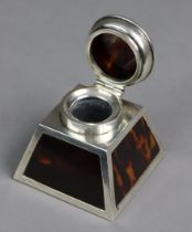 A silver & tortoiseshell inkwell of square tapered form, with hinged lid, Birmingham 1921 by Percy