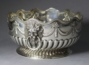 A VICTORIAN SILVER PUNCH BOWL with waved gadrooned rim, the sides embossed with swags, lion-mask &
