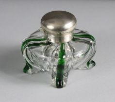 A late Victorian silver-mounted glass inkwell of compressed bombé form, quartered by green vertical