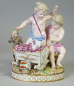 A Meissen porcelain figure group after Schönheit of 'Two putti playing with a cradle and a monkey