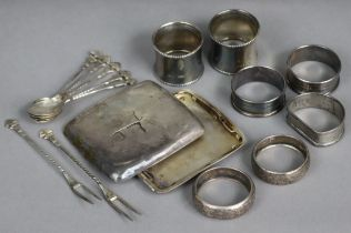 Seven various silver napkin rings; a silver cigarette case (w.a.f.); & a set of foreign coffee