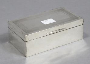 *WITHDRAWN* A George V silver cigarette box of rectangular shape, with engine-turned border to the