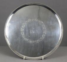 "A George III silver circular salver, 12"" diam. ,with raised beaded edge, engraved foliate scroll"