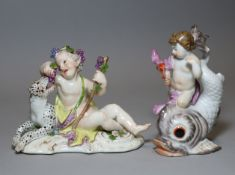 An 18th century Meissen porcelain figure of a reclining putto feeding grapes to a leopard, on scroll