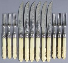 Six pairs of Edwardian silver dessert knives & forks, with engraved & embossed decoration, & foliate