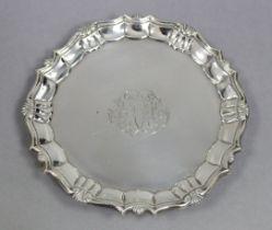 "A George II silver waiter with ""pie-crust"" edge, engraved monogram, & on three pad feet, 6½"""