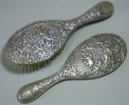 A late 19th/early 20th century Indian silver-backed hand mirror & matching hairbrush, with all-