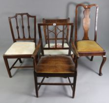 A cottage carver dining chair, with hard seat & on square tapered legs with plain stretchers;