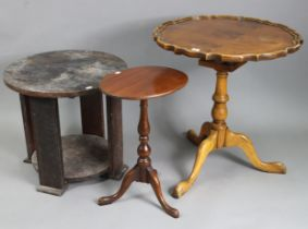 A reproduction yew wood tripod table with circular tilt-top, & on vase-turned centre column &