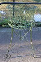 """A green painted wire-work garden plant stand, 20"""" diameter x 33½"""" high."""