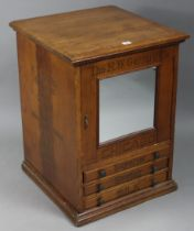 """An American wooden spool cabinet inscribed to front """"THE H. W. GOSSARD CO"""", enclosed by a mirror"""