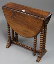 A late 19th/early 20th century walnut Sutherland table with rounded ends & moulded edges to the
