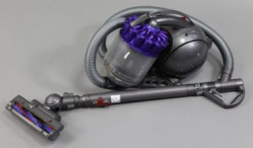 A Dyson cylinder vacuum cleaner.