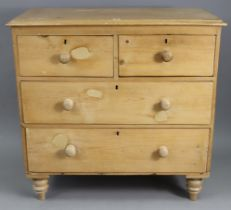 A pine small chest, fitted two short & two long graduated drawers with turned knob handles, & on