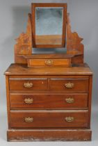 A late Victorian walnut dressing chest with rectangular swing mirror to the stage back, fitted two