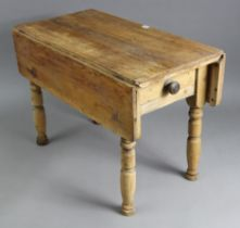 """A pine drop-leaf kitchen table (reduced in height), fitted end drawer & on turned legs, 32¼"""" wide"""