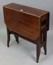 A late 19th/early 20th century inlaid-mahogany Sutherland table with canted corners to the