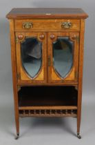 A 19th century inlaid-rosewood upright sheet-music cabinet fitted with a frieze drawer above a