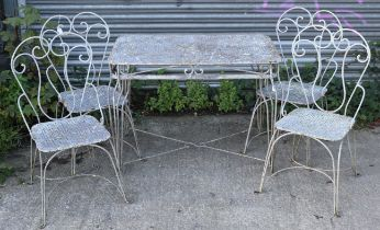 A white painted aluminium & wrought-iron garden table with rectangular top, & on four shaped legs