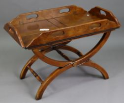 """A reproduction walnut butler's-tray coffee table on X-shaped supports with turned stretchers, 32"""""""