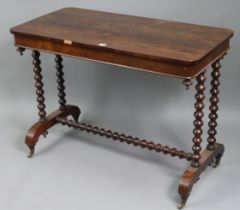 A 19th century rosewood centre table with rounded corners to the rectangular top, & on a pair of