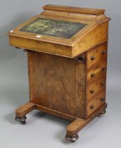 A Victorian inlaid-walnut davenport, inset gilt tooled leather to the hinged sloping front, fitted