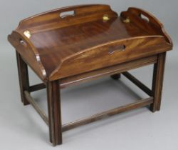 A mahogany butler's-tray type rectangular low coffee table on moulded square legs with plain