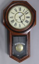 A late 19th/early 20th century American drop-dial regulator wall clock by the Ansonia Clock Co.,