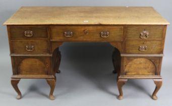 "An 18th century-style oak knee-hole desk, bears plaque ""Manufactured By JAMES PARKINSON, 34, Claren"