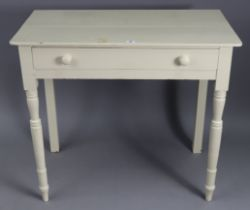 """A white painted pine side table, fitted frieze drawer & on turned tapered legs, 33½"""" wide x 29½"""""""