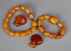 Two amber bracelets; & a pair of amber cuff-links. 43g total.