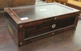 A late Regency rosewood writing box with carved bead bordered ornament, the angled,