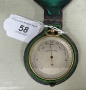 A late 19thC gilt metal cased pocket compensating barometer, faced by an engraved, silvered dial,