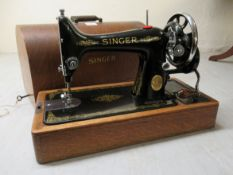 An early 20thC Singer manual sewing machine, model no.