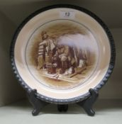 A Grimwades china wall plate 'Barnsfather - Old Bill', a souvenir of the Great War,