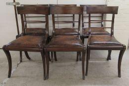 A set of six Regency mahogany framed, twin bar back dining chairs,