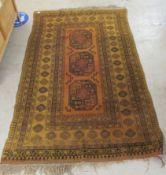 A Bokhara rug with three octagonal guls,