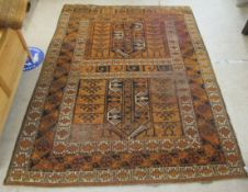 A Caucasian rug, decorated with repeating stylised designs,