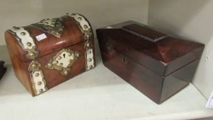 A Regency rosewood tea casket of sarcophagus form with a bead border and a hinged lid,