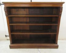 A late Victorian mahogany open front dwarf bookcase with three shelves,