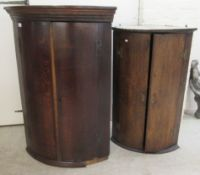A George III oak quadrant corner cabinet with a pair of doors, on a plinth 41.5''h 28.