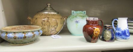 Doulton ware: to include a buff glazed china sugar basin with an inscribed motto;