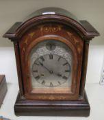 An Edwardian satinwood inlaid mahogany bracket clock;