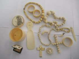 Decoratively carved and turned ivory objects: to include a cylindrical box,