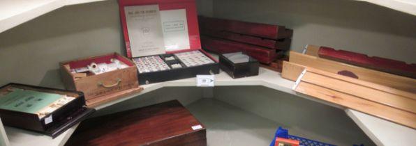 Three modern Mah-Jongg sets with various racks;