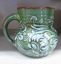 A Branham Barham ware green and brown glazed pottery cream jug,