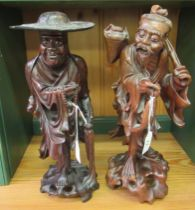 Two similar early 20thC Oriental carved hardwood, standing figures,