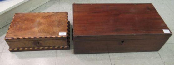 An unfitted late Victorian mahogany writing box with an angled,