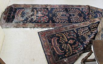 A Persian runner, decorated with foliate designs,